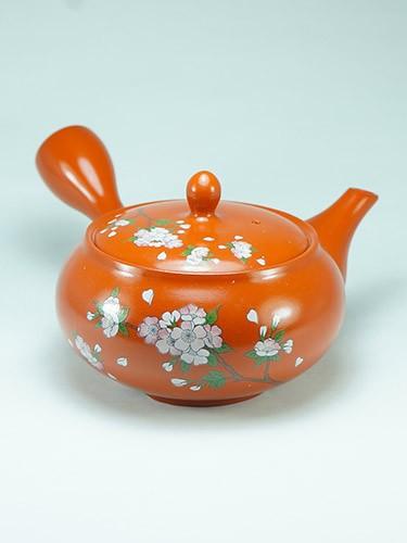 Orange teapot cherry flowers